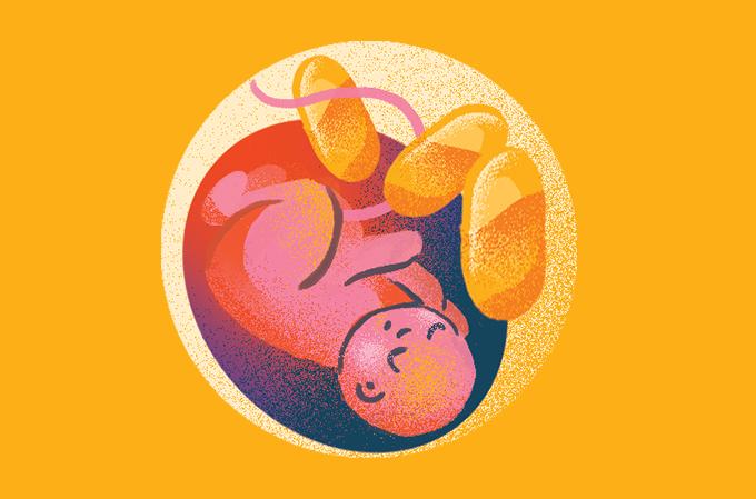 ilustração de bebê no útero com cápsulas em volta