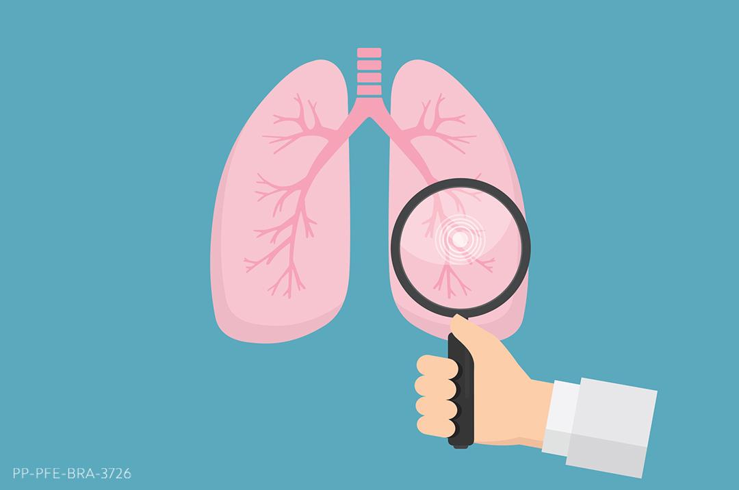 Pulmão humano com uma mão segurando uma lupa